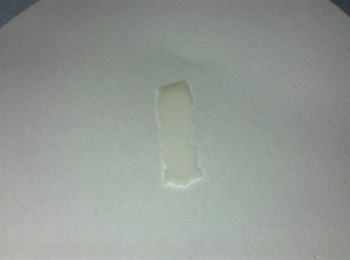 a piece of fluorographene on a filter paper